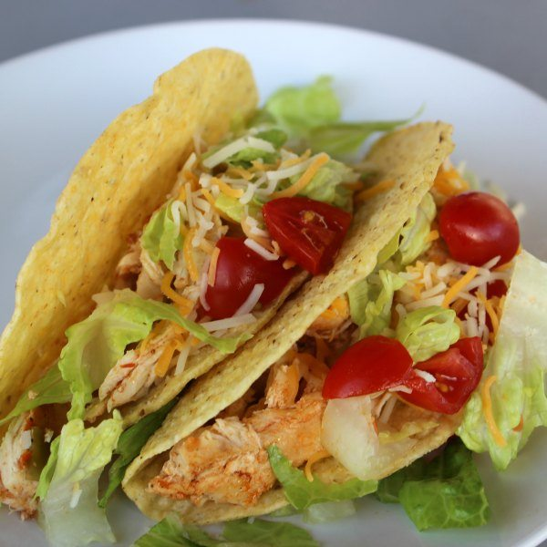 Shredded chicken thighs, infused with the flavors of garlic, ancho chile powder and tomatoes, make a delicious taco filling in just eight minutes thanks to your pressure cooker or Instant Pot.
